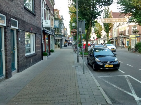 Side road is between buildings on the left.