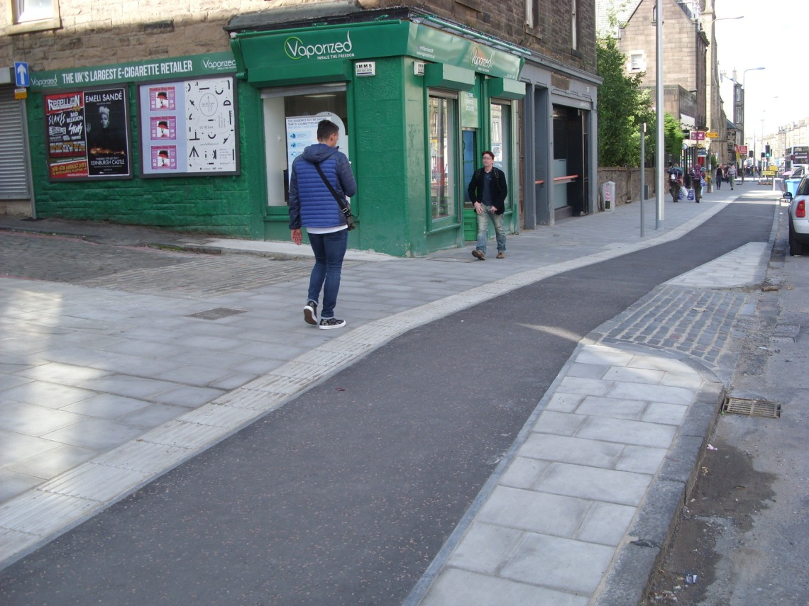 Image shows a new continuous footway, with some of the features discussed earlier.