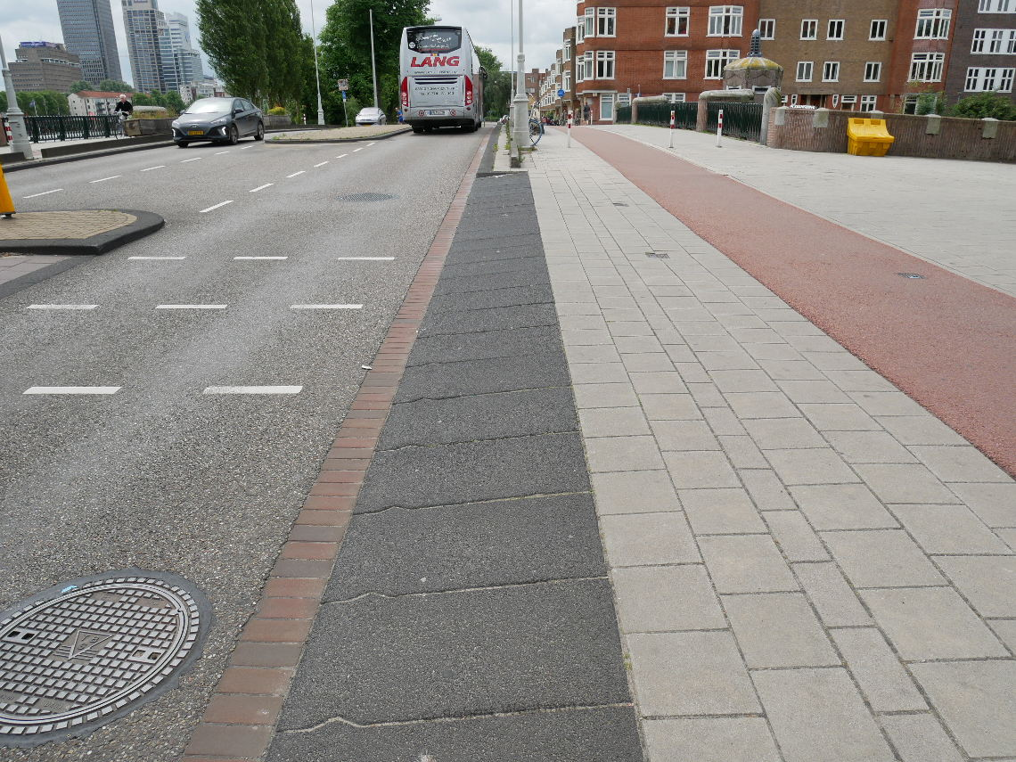 Image shows a close up of the inritbanden ramps used by vehicles to mount the footway.