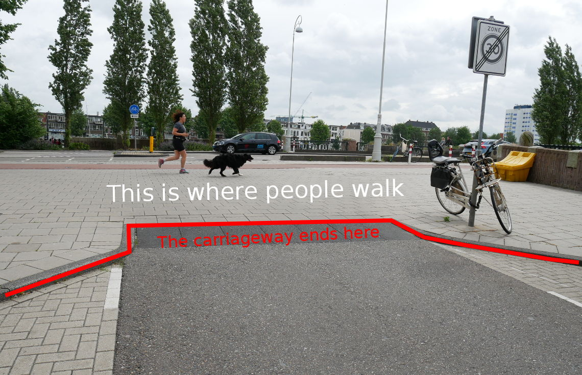 Image shows a second photo of the continuous footway, but with lines and words drawn on it to highlight the way that people read what they see to understand how to behave.